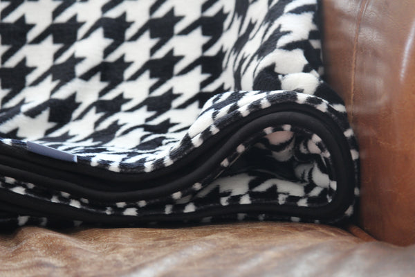 black and white houndstooth fleece throw close up