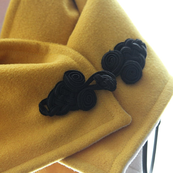 golden yellow and ivory neck wrap with black frog fastener detail