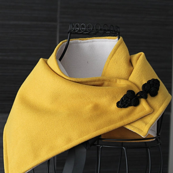 golden yellow and ivory neck wrap with black frog fastener