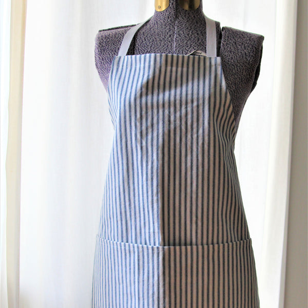 Full apron in white with navy blue ticking stripe displayed on a mannequin