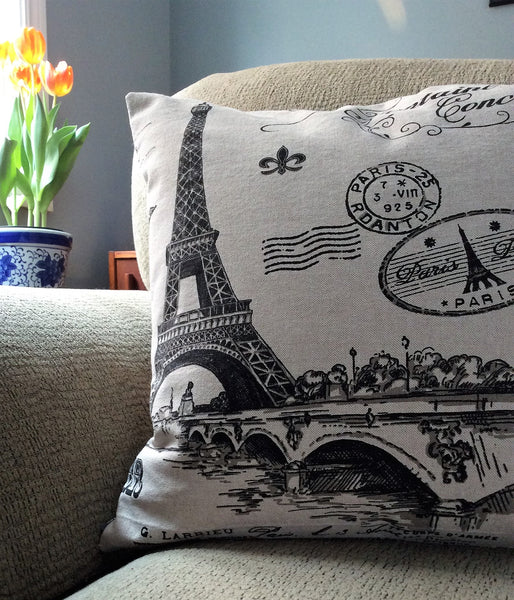 Paris print accent cushion in tan with black images and zippered closure