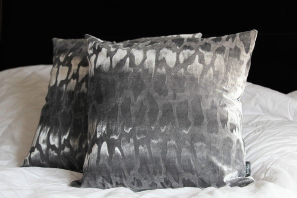 silver velvet accent cushion with embossed motif