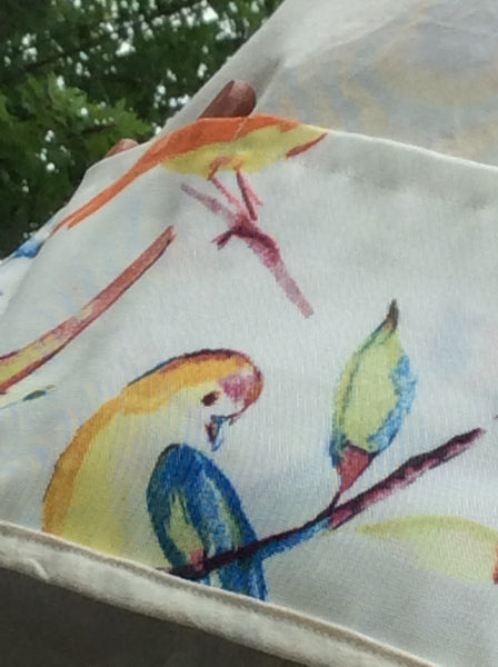 garden apron with colourful bird print close-up