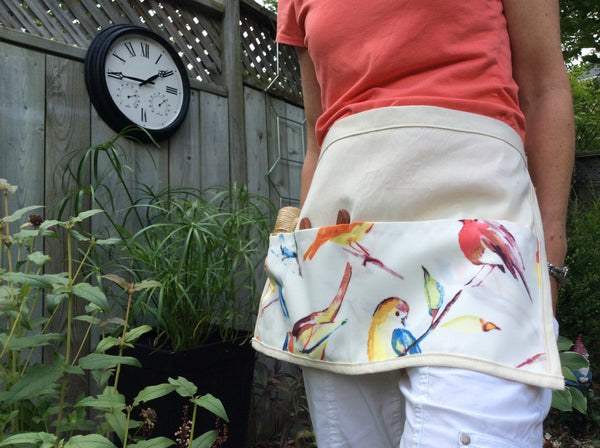 garden apron in ivory with colourful bird print