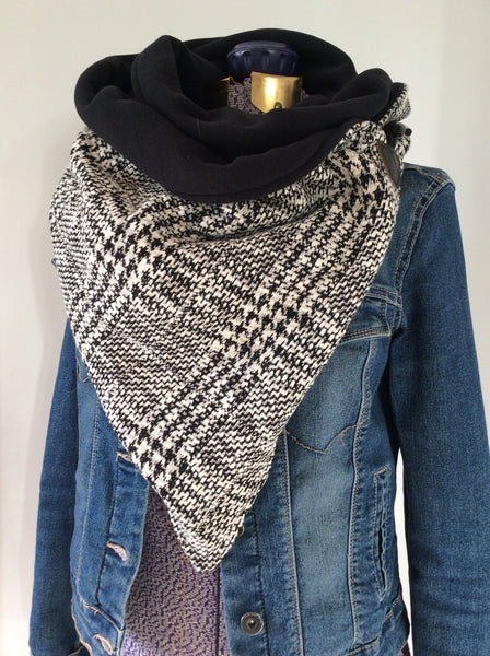 large neck wrap in black and white houndstooth pattern with toggle closure