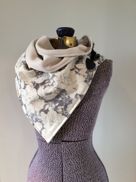 neck wrap in linen floral in ivory and grey with microfleece lining and a toggle fastener