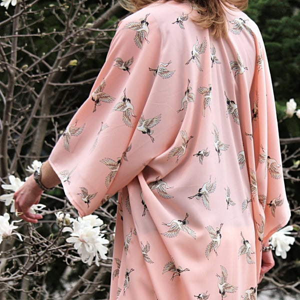 Light pink kimono cardigan with flying cranes back view