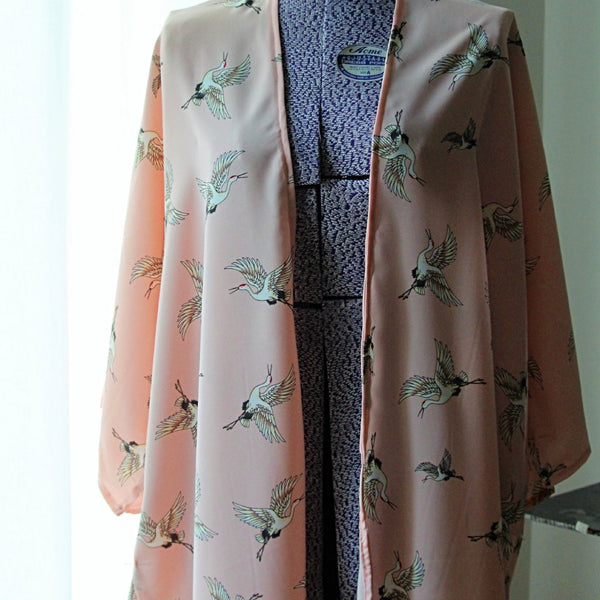 Light pink kimono cardigan with flying cranes front view