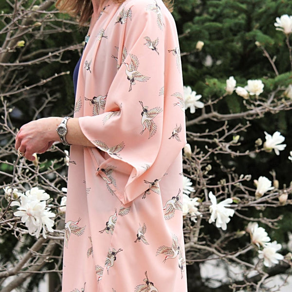 Light pink kimono cardigan with flying cranes side view