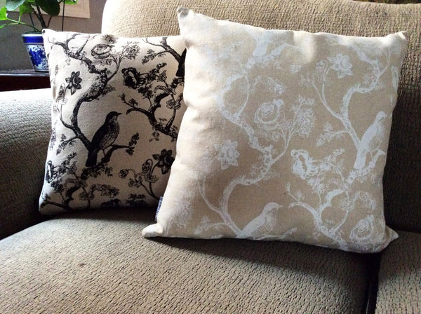 Tan accent cushions with white or black bird and flower images