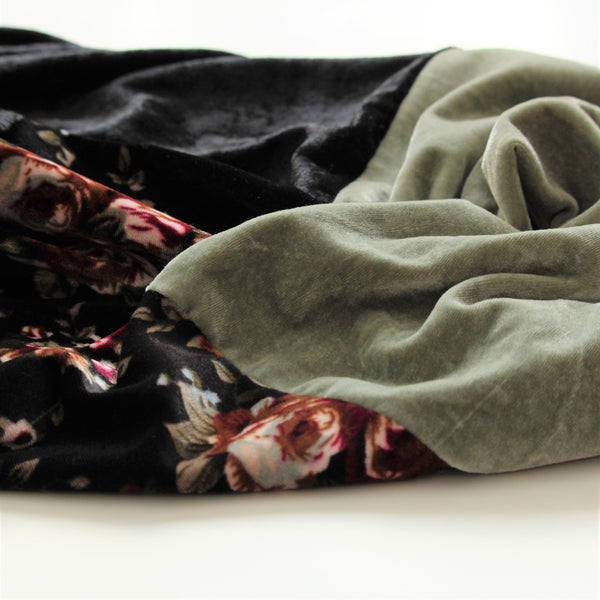 handmade velvet scarf sage green black and floral fabric flatlay close up