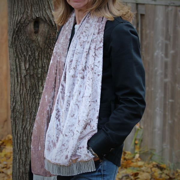 handmade velvet scarf taupe colour on a woman standing outside beside a tree