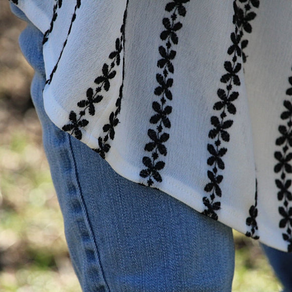 white kimono cardigan with black embroidered stripes hem detail