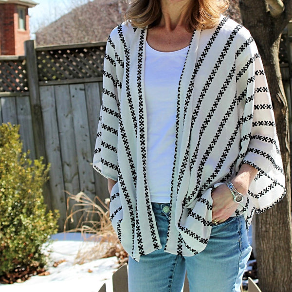 white kimono cardigan with black embroidered stripes tunic length