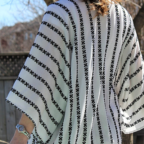 white kimono cardigan with black embroidered stripes back view