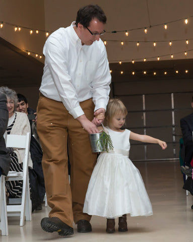 Little flower girl with dad