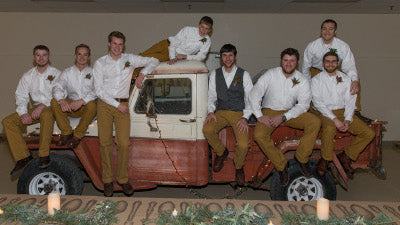 Groomsmen and groom on the truck