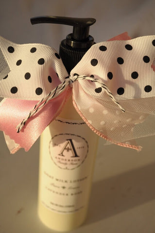 Organic natural lavender rose goat milk lotion bottle with pink and white polka dot ribbon