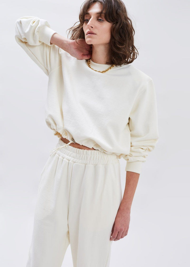 Cinch Hem Shoulder Pad Sweatshirt in Cream Sweatshirt The Frankie Shop