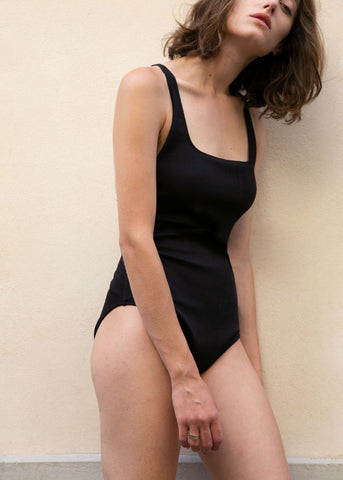Ganni Crossed Back Textured One Piece Swimsuit in Black swimsuit Ganni