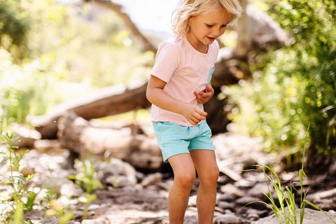 Child playing outside in Lark Adventurewear