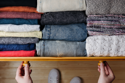 Neatly ordered clothes in drawer