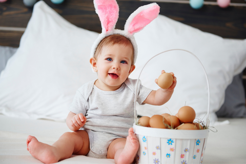 adorable baby girl with easter basket