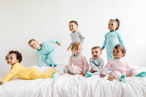 children on a bed
