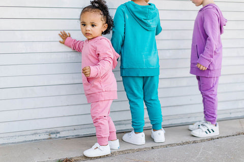 three toddlers standing outside