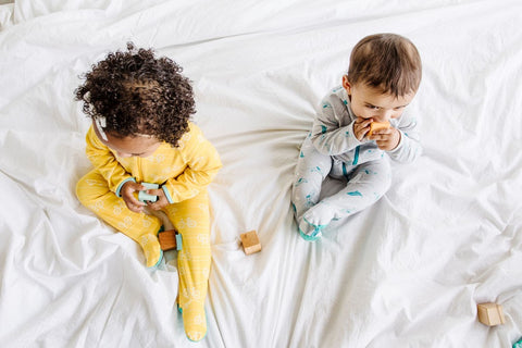 two babies in lark adventurewear pajamas