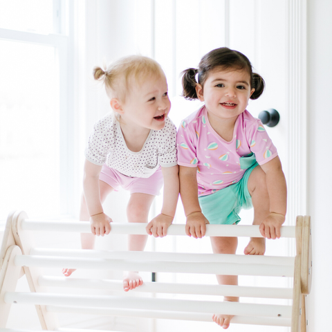 two toddlers in colorful lark adventurewear pajamas