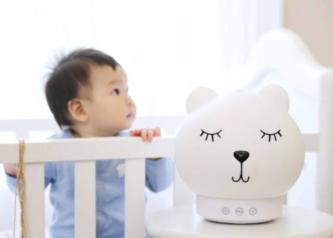 white noise machine with baby in background