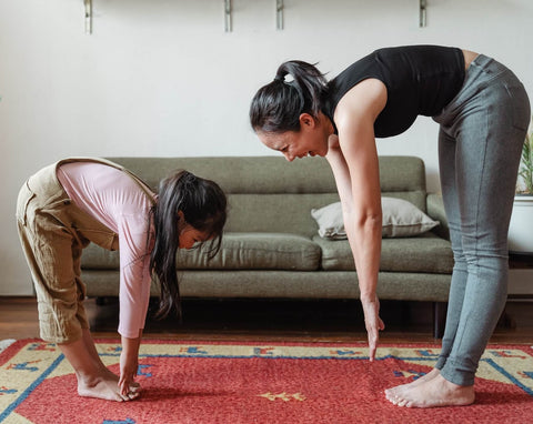 woman and young child stretching together