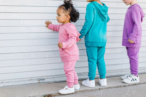 young children dressed in pastel clothes from lark adventurewear