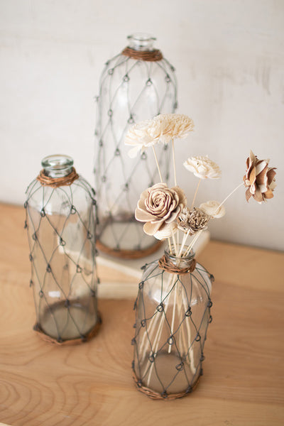 Set Of Three Tall Wire And Wicker Wrapped Glass Bottles