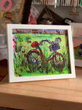 Old bicycle in a flower field print