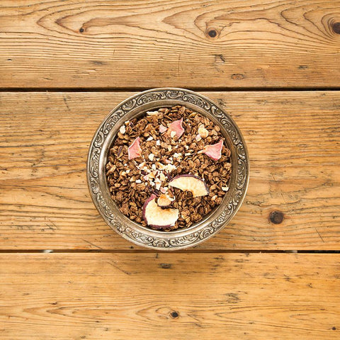 granola in silver bowl on wood