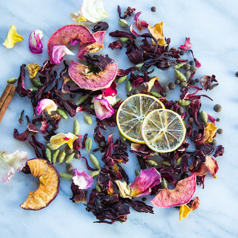 spices, dried apples, hibiscus, cinnamon sticks, dried citrus, cardamon pods, dried rose petals