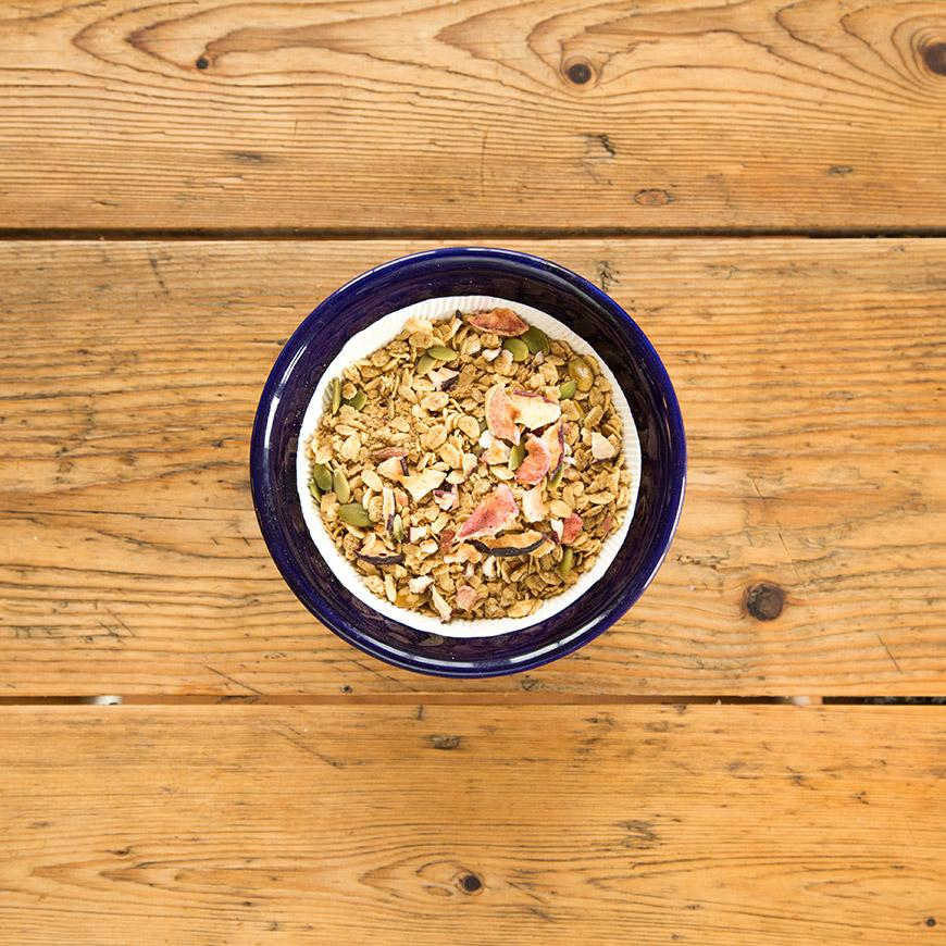 granola in blue bowl on wood new world blend