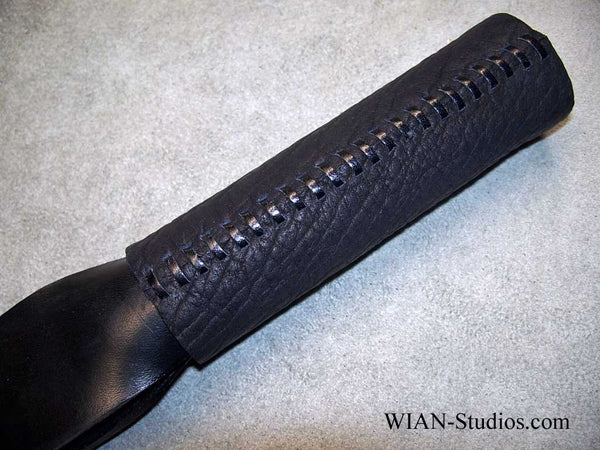 The Bandit, a Black Latigo Slapper, Black handle with Red Kangaroo Lacing