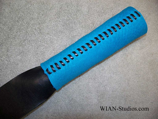 The Bandit, A Black Latigo Slapper, Turquoise handle
