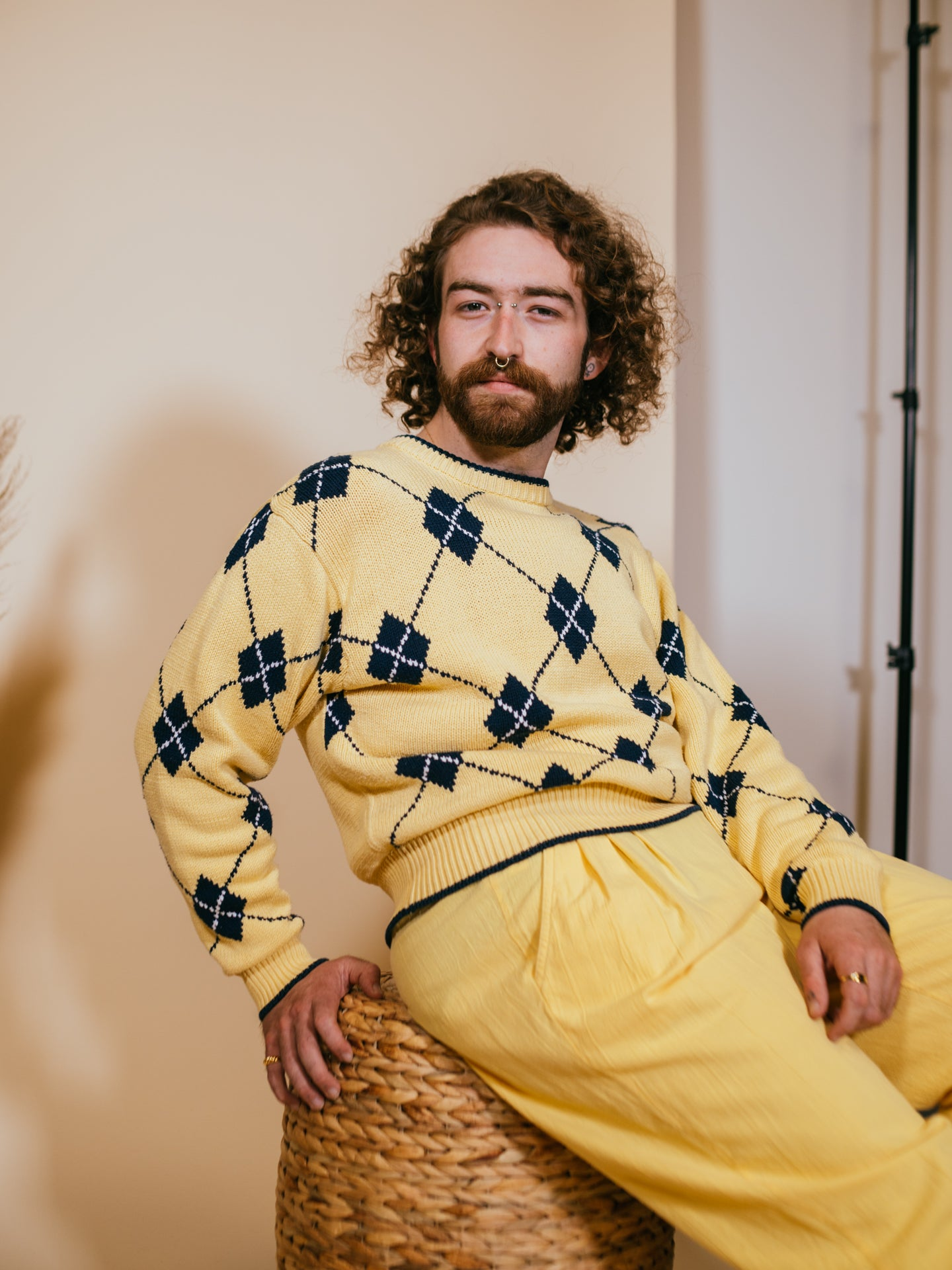 model in yellow argyle sweater