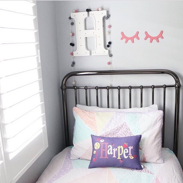 girls bedroom inspiration with purple personalised cushions