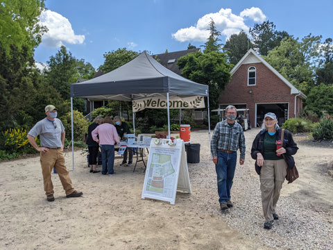 Image of volunteers manning the Welcome tent during our Open Nursery & Garden Days.