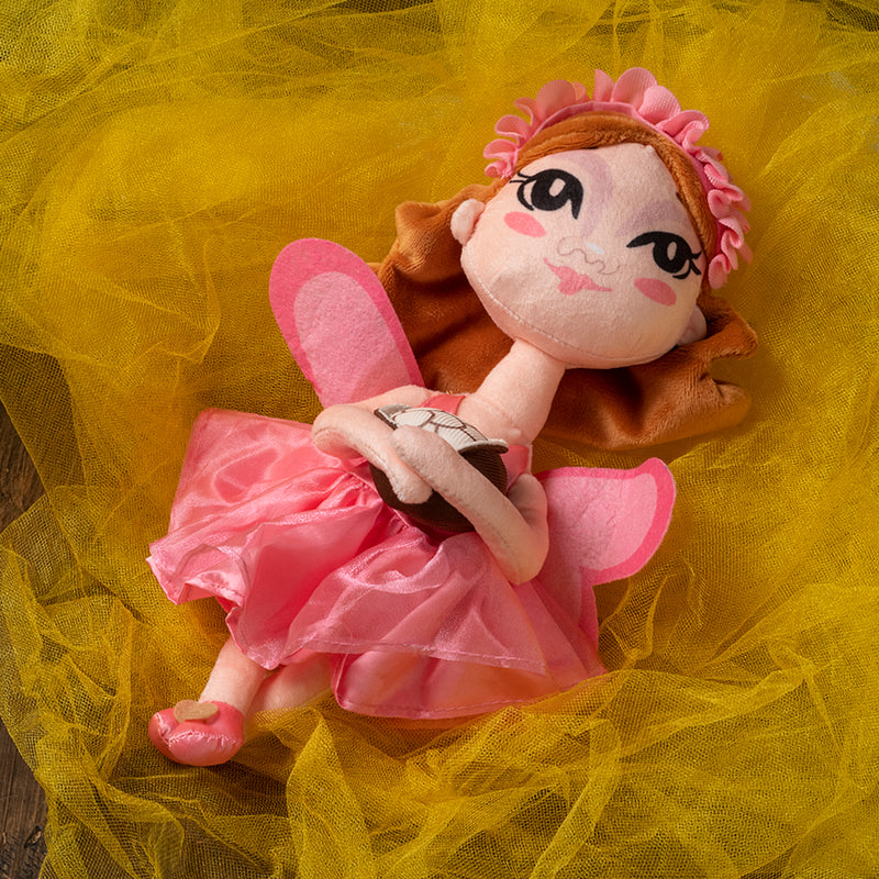 Sugarbelle, the Cookie Fairy, is soft plushy doll, and ready to go on all your adventures!