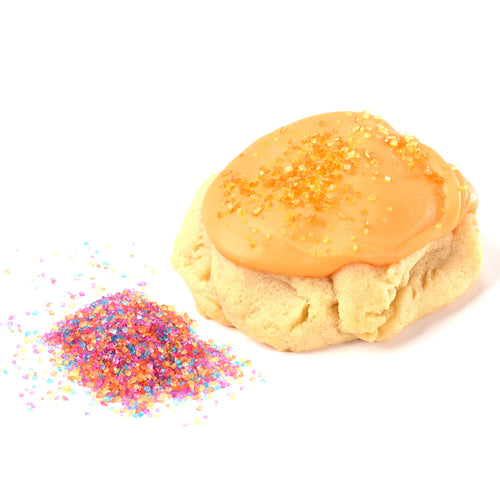 Light and scrumptious vanilla-based dough dipped in vanilla icing with colorful sprinkles on top! Colors and sprinkles change with each season!