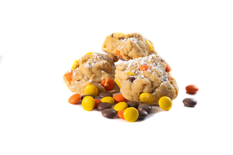 Our Creamy peanut butter dough, mixed with Reese's Pieces, and sprinkled with powder sugar on top! Nom nom nom.