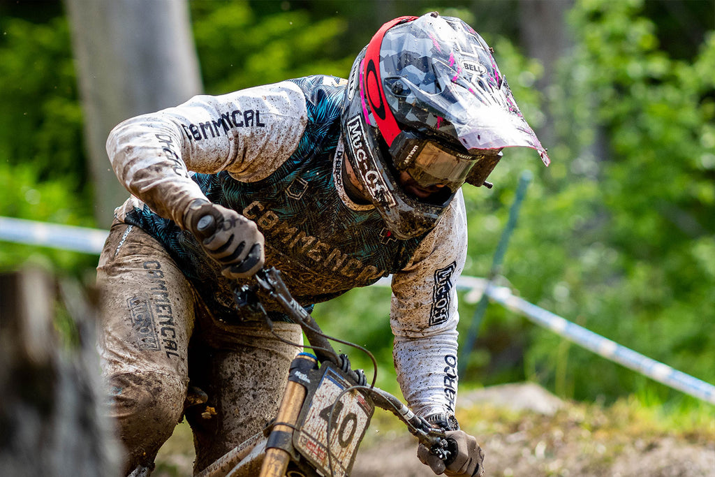Commencal Muc-off riding through muddy conditions