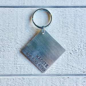 Modern Dog dog name tag handmade in Bozeman, Montana.  Unique metal dog tags, pet id tags personalized for you, and handmade dog tag art make special gifts for special dog moms and dads.  Hammered silver and rose gold jewelry for dogs and dog lovers.