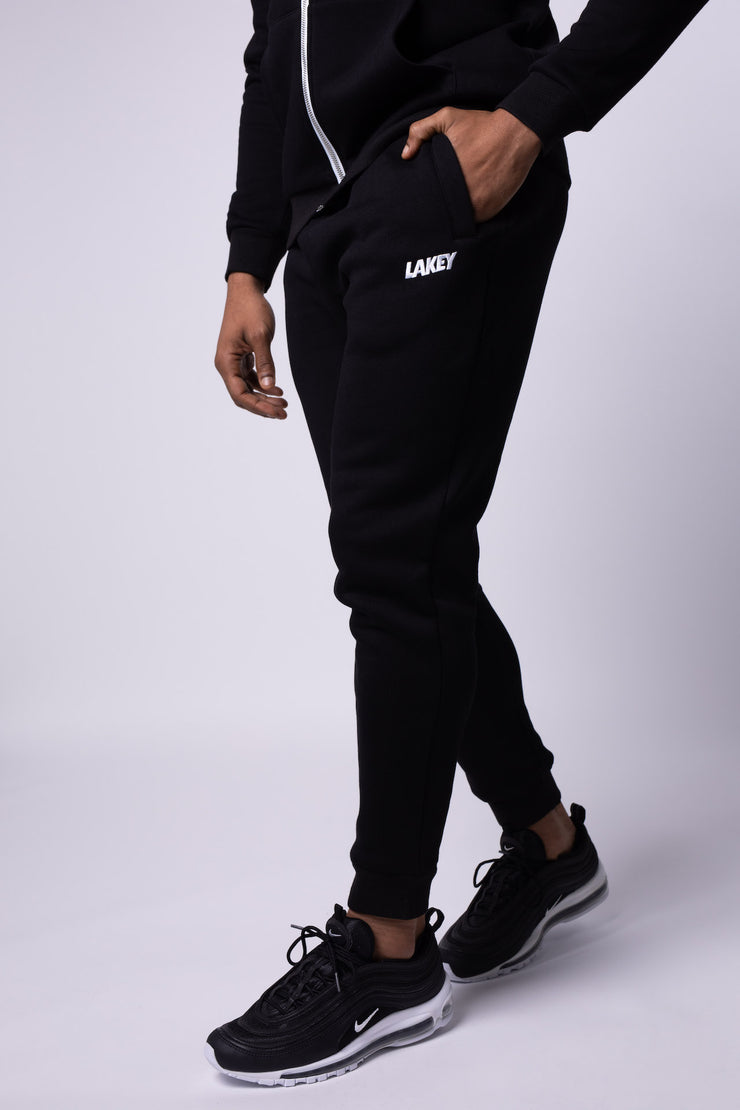 BLACK STAPLE JOGGERS